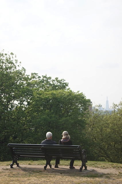 Park bench and couple